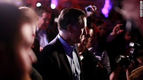 SAN DIEGO, CA - JANUARY 16: Mitt Romney is greeted by fellow Republicans at a dinner during the Republican National Committee's Annual Winter Meeting aboard the USS Midway on January 16, 2015 in San Diego, California. Romney is contemplating a possible 2016 presidential run.