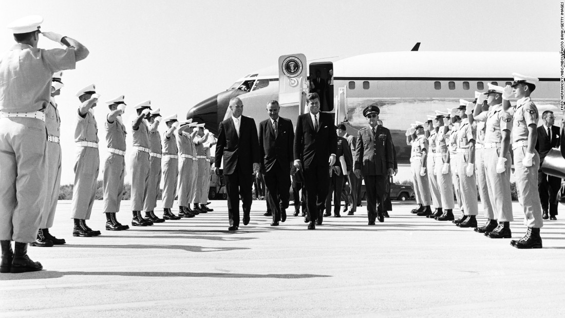 "From left, astronaut John Glenn, Vice President Lyndon B. Johnson, and President John F. Kennedy arrive at Cape Canaveral Air Force Station in February 1962. Kennedy was the first president to use a customized Boeing VC-137C as Air Force One. The plane was a military version of the Boeing 707. Code-named ""SAM 26000,"" this jet served presidents for more than three decades."
