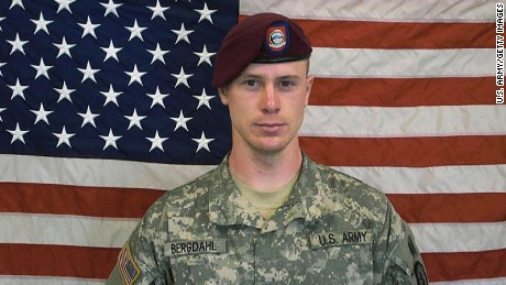 In this undated image provided by the US Army, Sgt. Bowe Bergdahl poses in front of an American flag. (Photo by US Army via Getty Images)