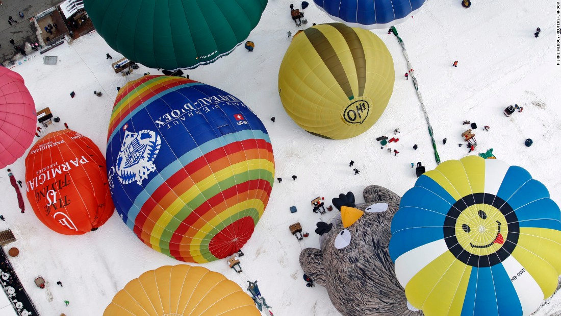 Hot-air balloons of all shapes and sizes get ready for takeoff Saturday, January 24, in Chateau-d'Oex, Switzerland. More than 80 balloons from 20 countries were set to take part in International Hot-Air Balloon Week.