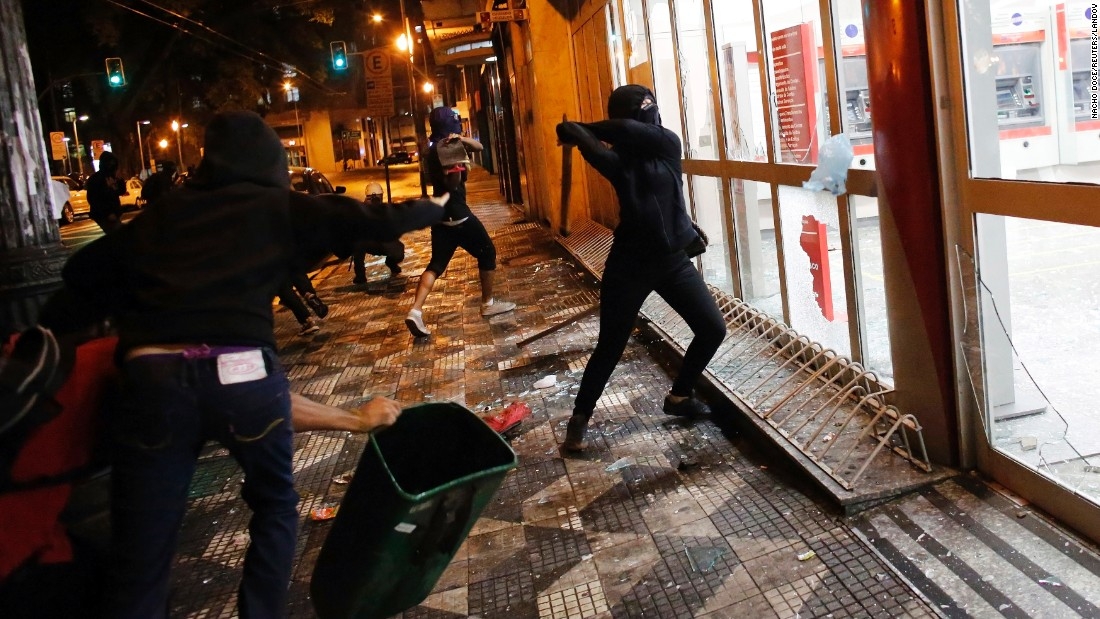 Demonstrators in Sao Paulo, Brazil, attack a Bradesco bank branch on Friday, January 23, while protesting increased fares for city buses and trains.