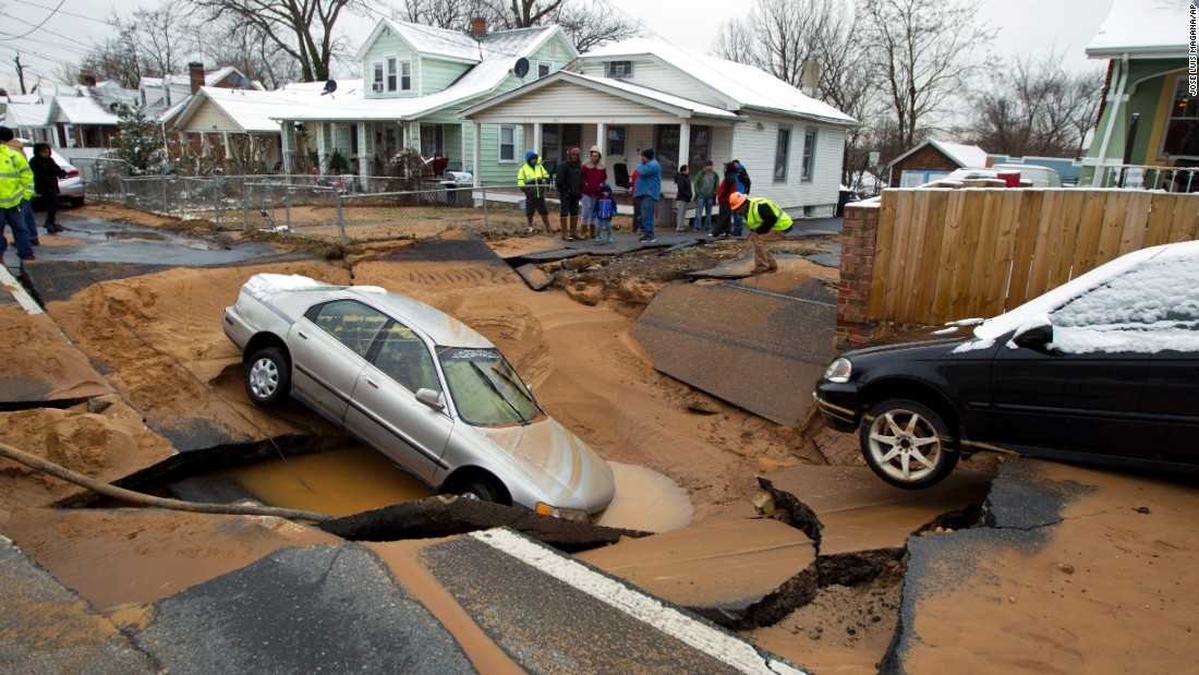 A water main break in Bladensburg, Maryland, caused a sinkhole that swallowed up a family's car just after they escaped on Tuesday, January 27.
