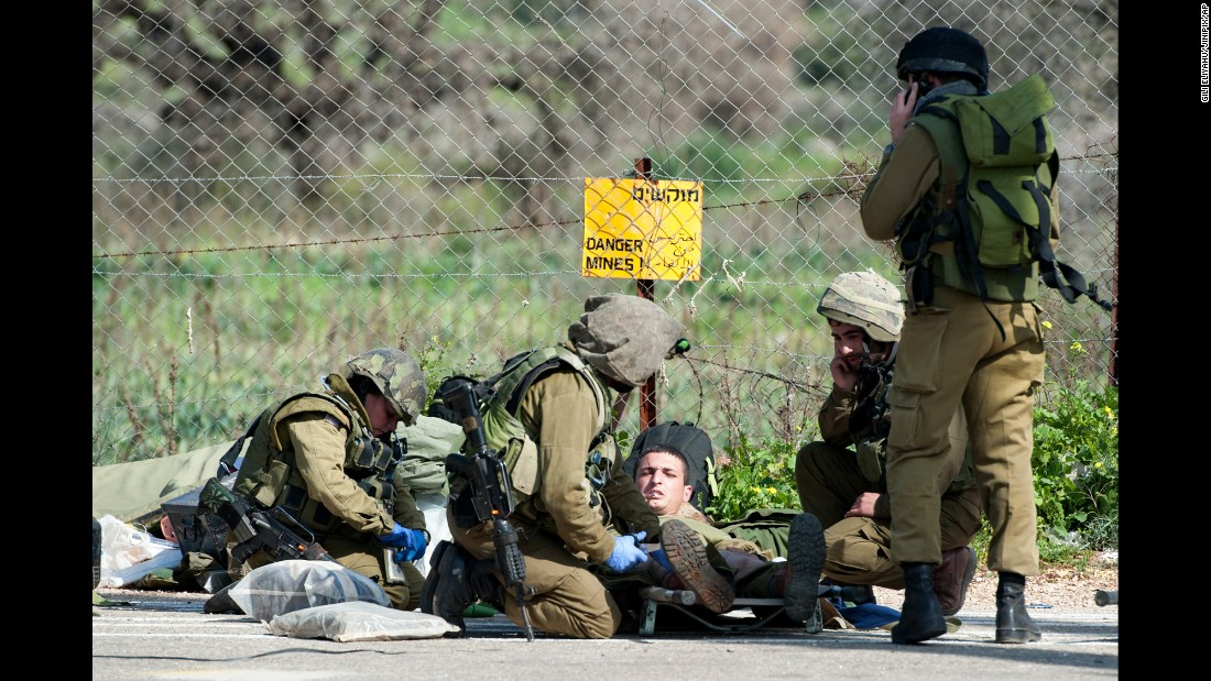 "Israeli soldiers treat a wounded soldier near the Israel-Lebanon border on Wednesday, January 28. <a href=""http://www.cnn.com/2015/01/28/world/gallery/israel-hezbollah-fighting/index.html"" target=""_blank"">Fighting between Israel and the Lebanese militant group Hezbollah</a> left two Israeli soldiers and a Spanish peacekeeper dead, officials said."