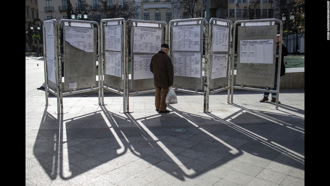 "A man looks at voting information ahead of parliamentary elections in Athens, Greece, on Sunday, January 25. The leader of the left-wing Syriza party, Alexis Tsipras, <a href=""http://www.cnn.com/2015/01/26/europe/greece-elections/index.html"" target=""_blank"">was sworn in as Greece's new Prime Minister</a> after forming a coalition with the right-wing Independent Greeks party."