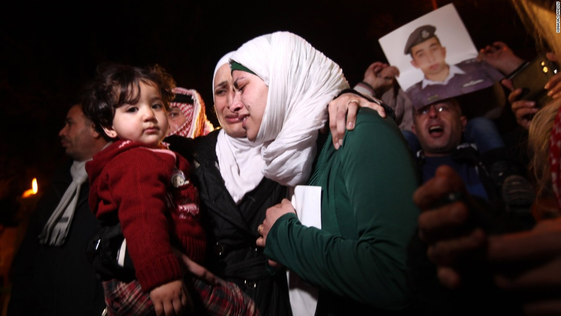 Relatives of Moaz al-Kassasbeh, a Jordanian pilot who was captured in December by ISIS militants, protest in front of the Royal Palace in Amman, Jordan, on Wednesday, January 28. ISIS has threatened to kill al-Kassasbeh and Japanese hostage Kenji Goto if Jordan does not release Sajida al-Rishawi, a convicted would-be suicide bomber.
