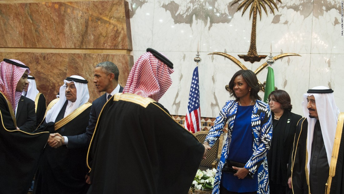 "U.S. President Barack Obama and first lady Michelle Obama shake hands with delegation members in Riyadh, Saudi Arabia, on Tuesday, January 27. President Obama was in the country to meet Saudi King Salman, right, and offer condolences on the death of his predecessor, <a href=""http://www.cnn.com/2015/01/22/world/gallery/king-abdullah/index.html"" target=""_blank"">King Abdullah</a>."
