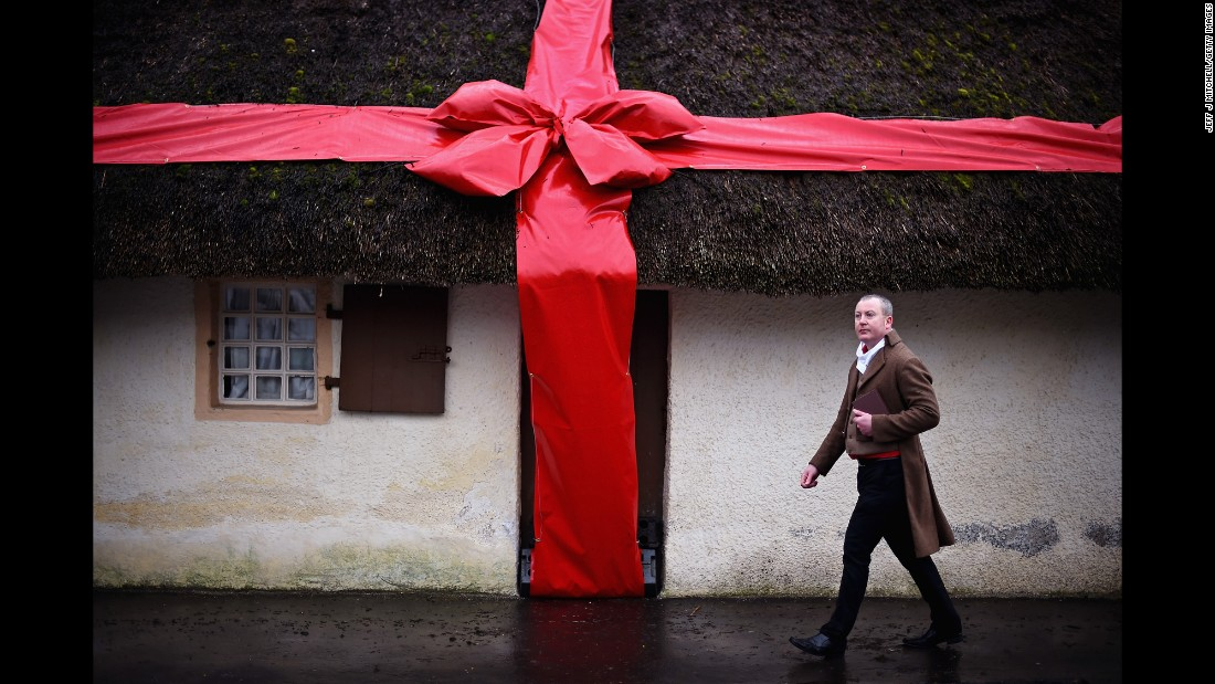 Stuart Cochrane, from the Burns Birthplace Museum in Alloway, Scotland, walks past the birthplace of famous poet Robert Burns on Friday, January 23.