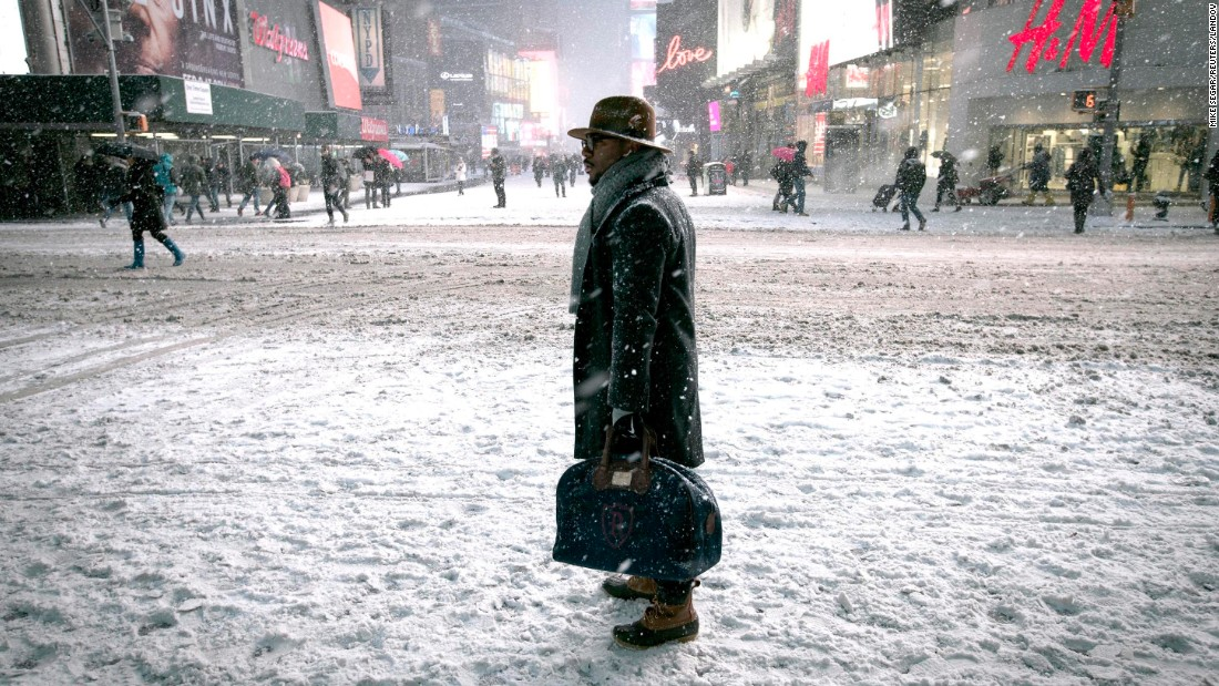 "A man stands in snow in New York's Times Square on Monday, January 26. <a href=""http://www.cnn.com/2015/01/23/world/gallery/week-in-photos-0123/index.html"" target=""_blank"">See last week in 32 photos</a>"