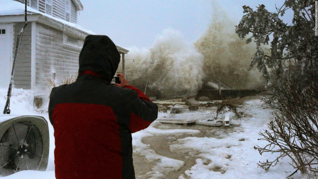 "Waves crash against an oceanfront house after a sea wall broke in Marshfield, Massachusetts, on Tuesday, January 27. The first blizzard of 2015 <a href=""http://www.cnn.com/2015/01/24/us/gallery/northeast-weather/index.html"" target=""_blank"">dumped nearly 3 feet of snow</a> in parts of four Northeastern states. Massachusetts was hit the hardest."