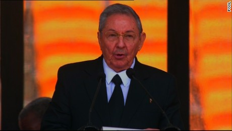Cuban President Raul Castro gives a tribute to Nelson Mandela at his public memorial on Tuesday, December 10, 2013.