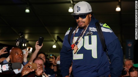 CHANDLER, AZ - JANUARY 29:  Running back Marshawn Lynch #24 of the Seattle Seahawks arrives to a Super Bowl XLIX media availability at the Arizona Grand Hotel on January 29, 2015 in Chandler, Arizona.  (Photo by Christian Petersen/Getty Images)