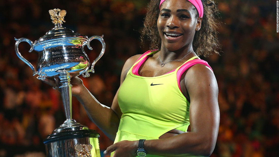 Serena Williams poses with the Daphne Akhurst trophy after beating Maria Sharapova in the Australian Open final.