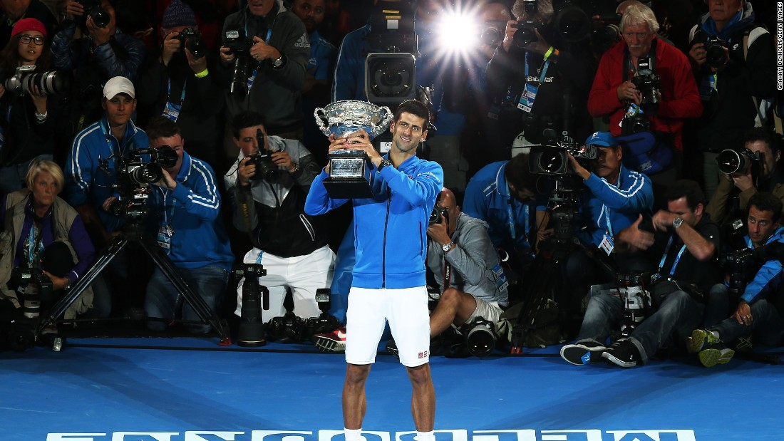 Novak Djokovic won his fifth Australian Open title by beating Andy Murray in a bruising four sets.