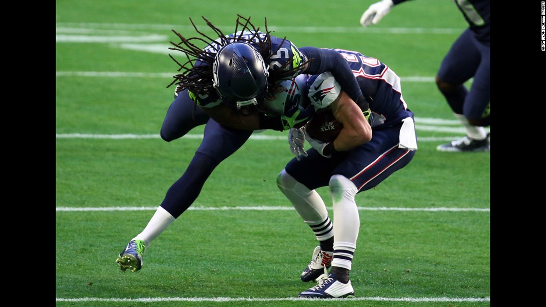 Seattle cornerback Richard Sherman tries to tackle Amendola.