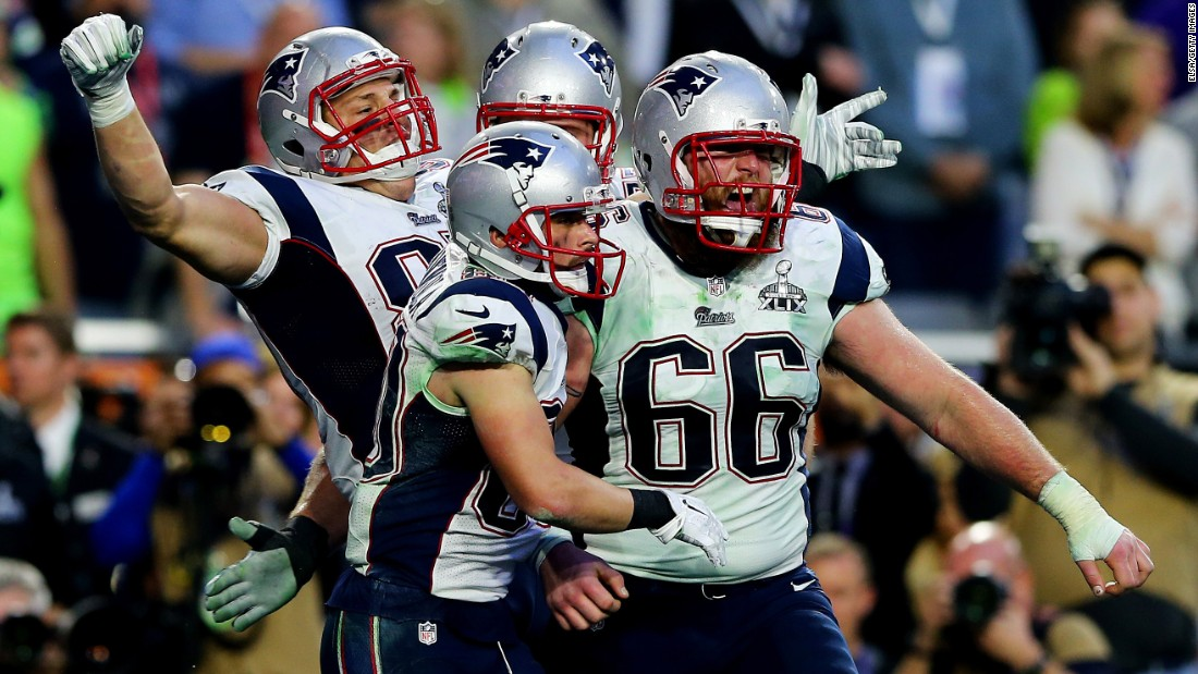 New England tight end Rob Gronkowski, left, celebrates with teammates after catching a 22-yard touchdown pass in the second quarter. The touchdown and the extra point gave the Patriots a 14-7 lead.