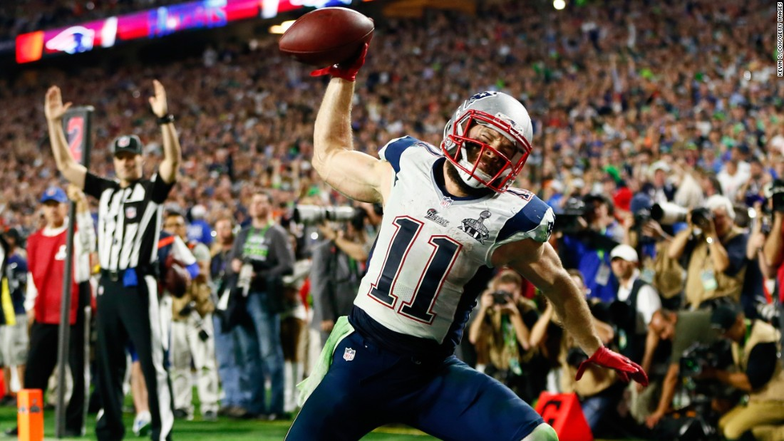 New England wide receiver Julian Edelman spikes the ball after his fourth-quarter touchdown catch gave the Patriots a lead they wouldn't relinquish.