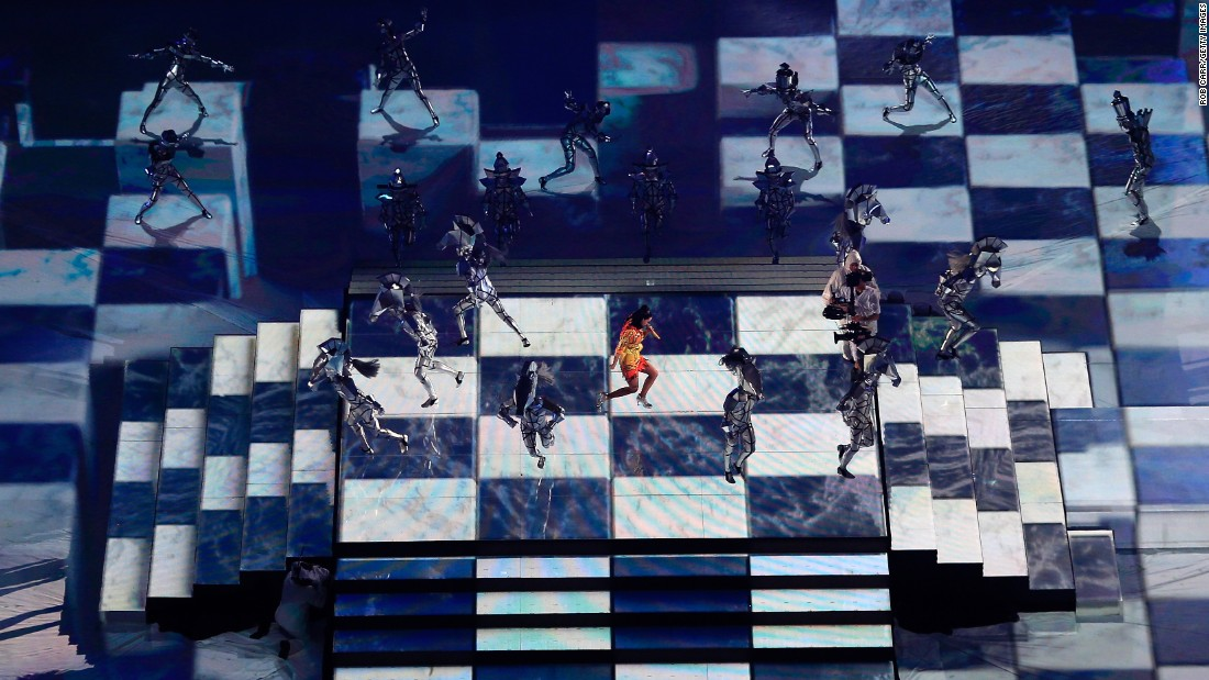 Perry performs on a checkerboard projected on the floor.