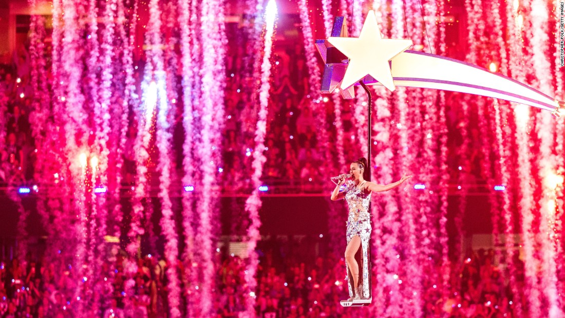 "Singer Katy Perry is carried above the stage as she performs ""Firework,"" the last song of the Super Bowl XLIX halftime show on Sunday, February 1."