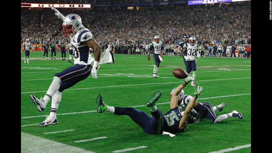 Seattle wide receiver Jermaine Kearse pulls off an incredible catch while lying on the turf during Seattle's last drive.