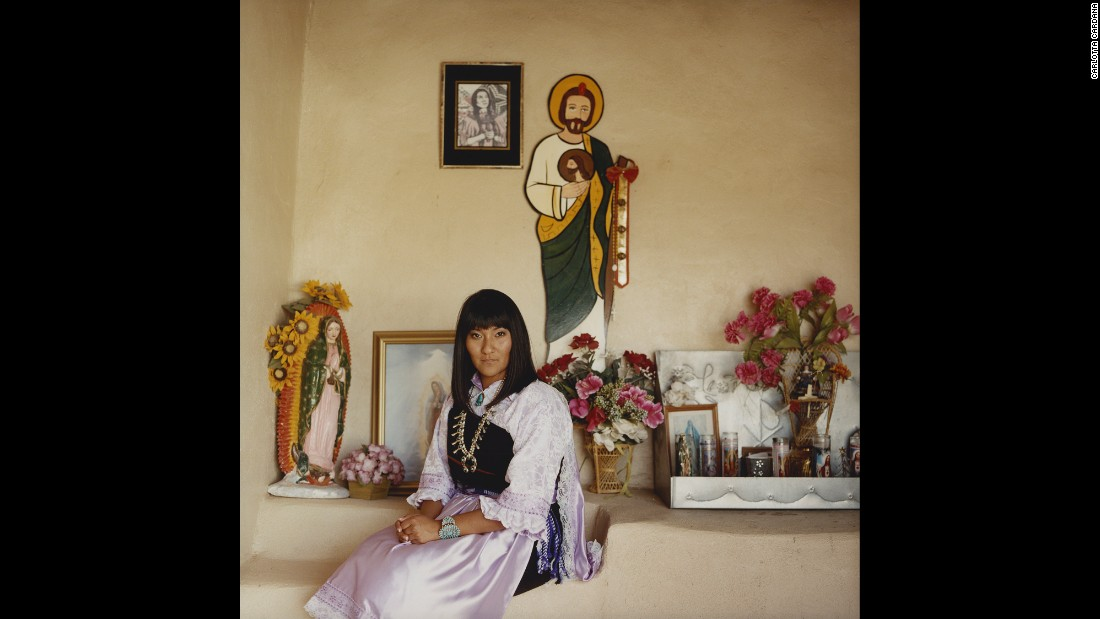 "Heather Abeita, 23, is photographed by the Catholic church in her New Mexico village. She is trying to pass a land and wildlife preservation bill on the Isleta Reservation. ""Agriculture is extremely important in my tribe not only for sustainability, but also for religious purposes,"" she said in ""Red Road."" ""The corn is very sacred to us, and we need a place to grow it and provide it to our own people."""