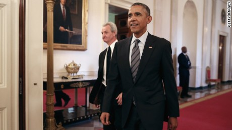WASHINGTON, DC - FEBRUARY 02: U.S. President Barack Obama (R) and National Hockey League champions Los Angeles Kings Head Coach Darryl Sutter walk into the East Room of the White House February 2, 2015 in Washington, DC. Obama simultaneously hosted the Kings and the Major League Soccer champions Los Angeles Galaxy. Both teams are owned in part by billionaire and The Weekly Standard publisher Philip Anschutz. (Photo by Chip Somodevilla/Getty Images)