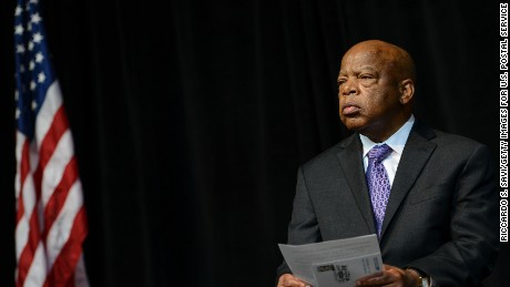 Caption: WASHINGTON, DC - AUGUST 23: John Lewis attends the U.S. Postal Service Unveiling of the 1963 March On Washington Stamp on August 23, 2013. (Photo by Riccardo S. Savi/Getty Images for U.S. Postal Service)