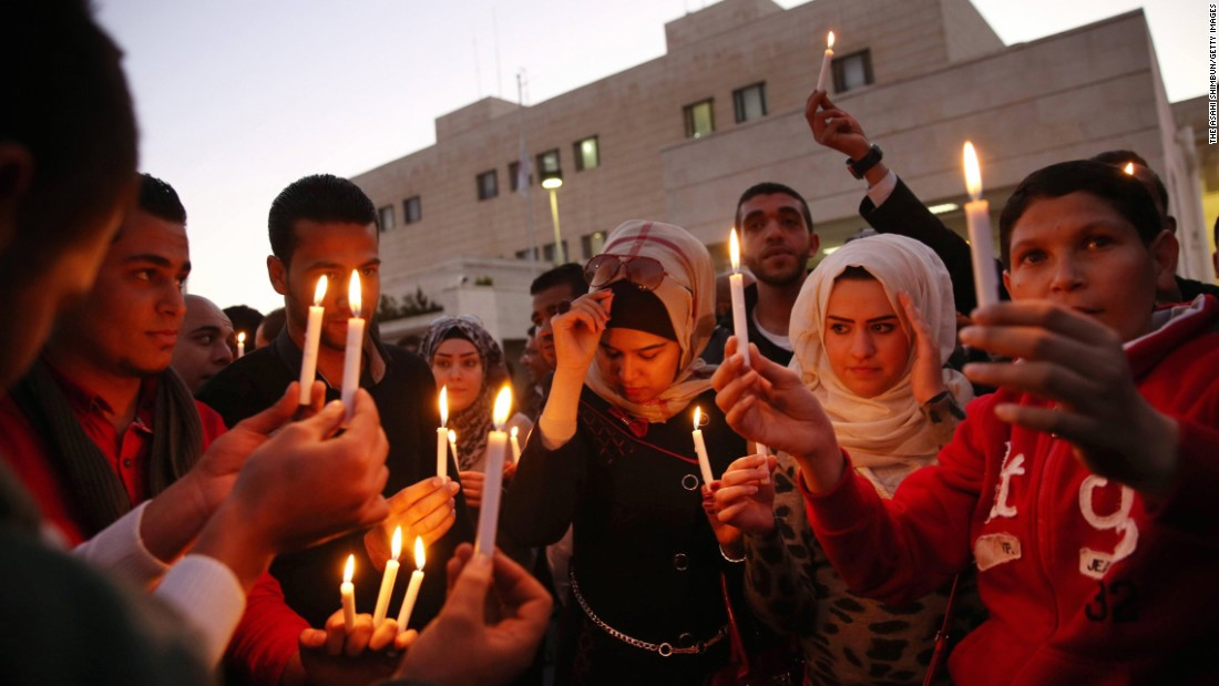 Jordanian youth gather for a candlelight vigil February 2 in Amman to condemn the killing of the two Japanese hostages.