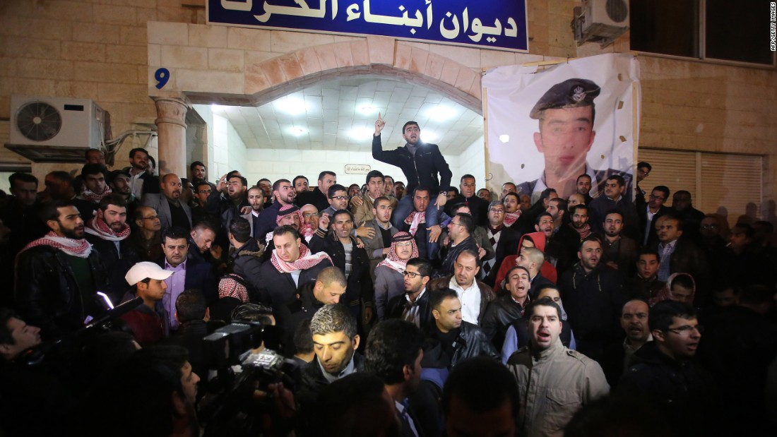 Supporters and family members of al-Kasasbeh gather in Amman after reports of his death on February 3.