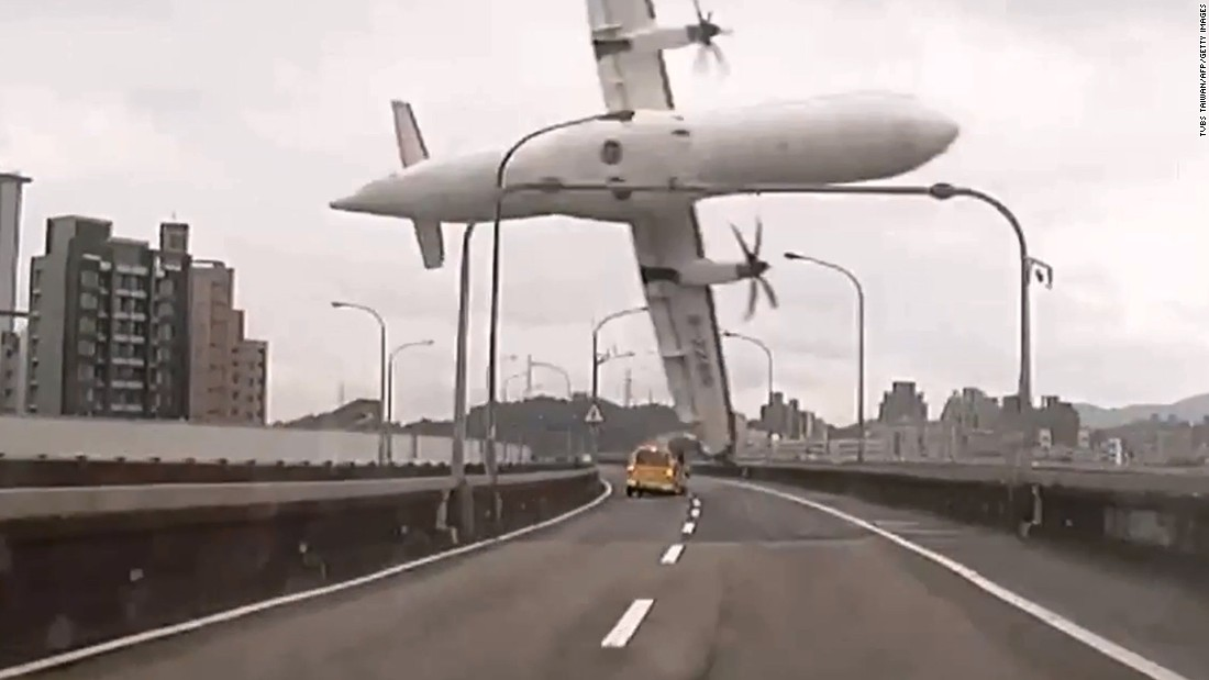 In this still image taken from video, TransAsia Airways Flight GE235 clips a bridge in Taipei, Taiwan, shortly after takeoff on February 4, 2015. There were 58 passengers on board the ATR 72 twin-engine turboprop airplane that plunged into the Keelung River.