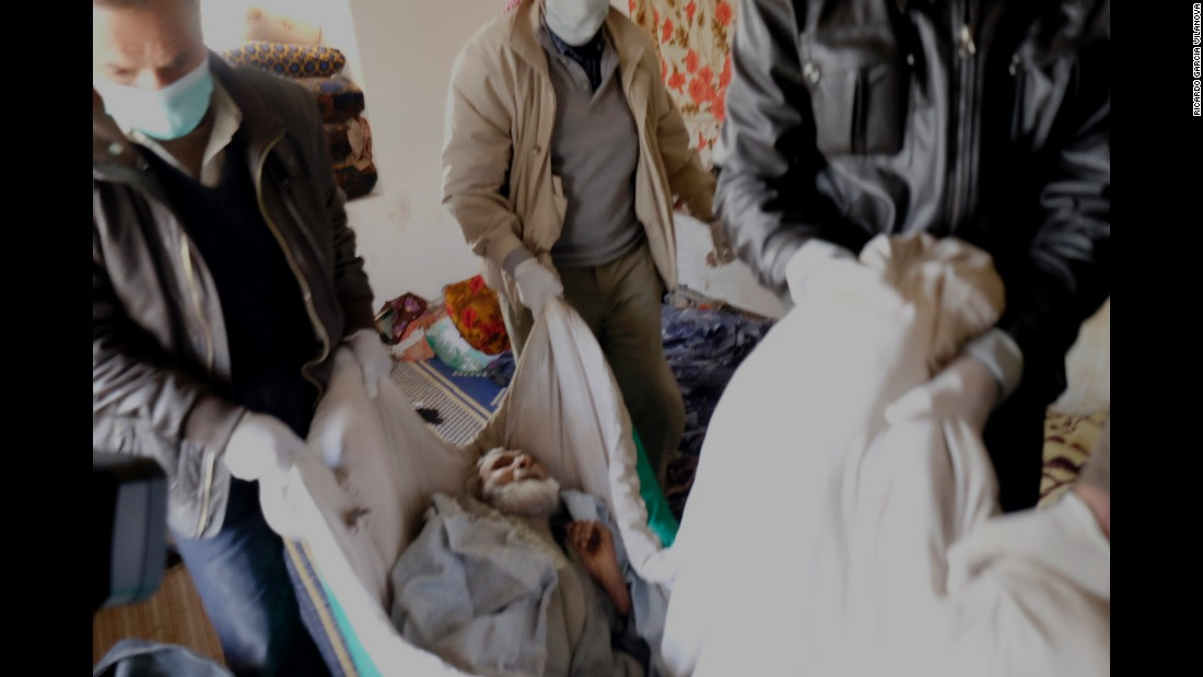 Ramue Dika, a civilian who died of starvation, is taken away from his house in Kobani on Monday, February 2.
