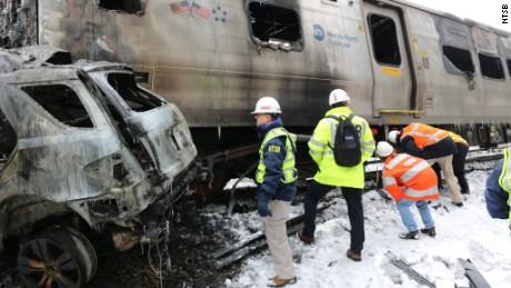 NTSB members at the scene of the Metro-North accident in Valhalla, New York.
