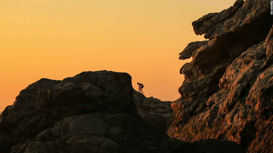 A climber navigates the rocky ridges above Artemis' Cove.