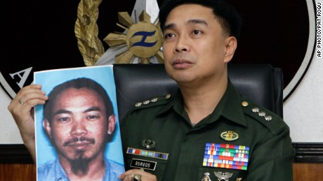 A Philippines Armed Forces spokesman shows a picture of Zulkifli bin Hir, also known as Marwan, in 2012.