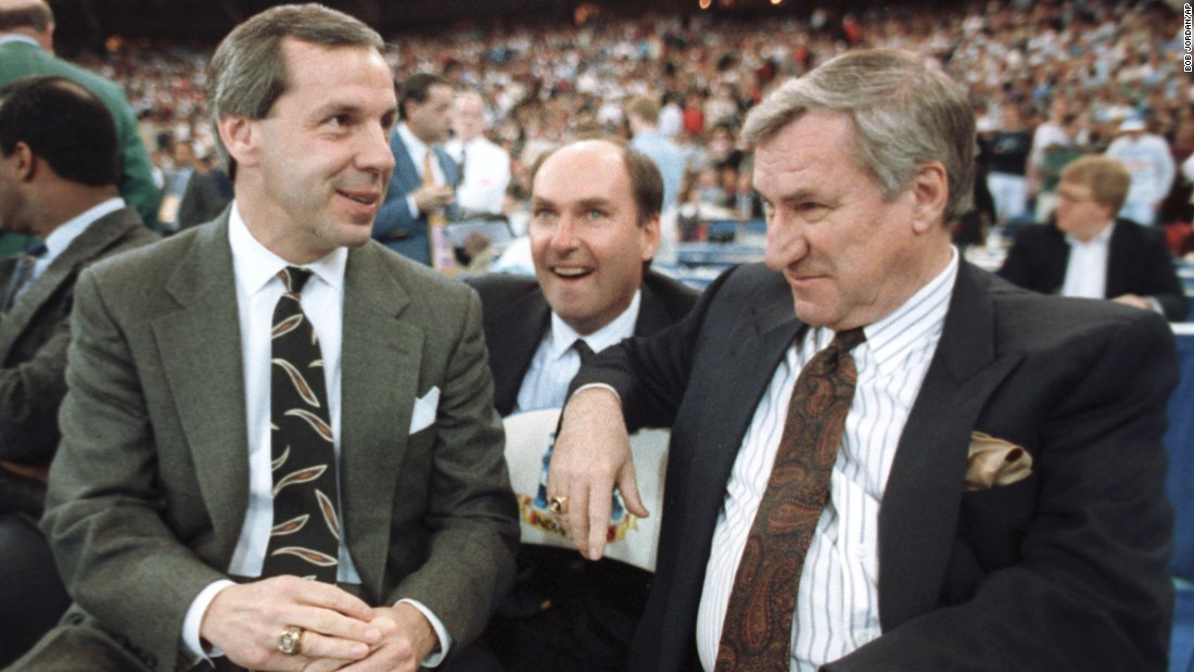 Then-Kansas coach Roy Williams, left, and Smith talk before the start of an NCAA semifinal game on March 30, 1991, in Indianapolis, Indiana. Williams now coaches the Tar Heels.