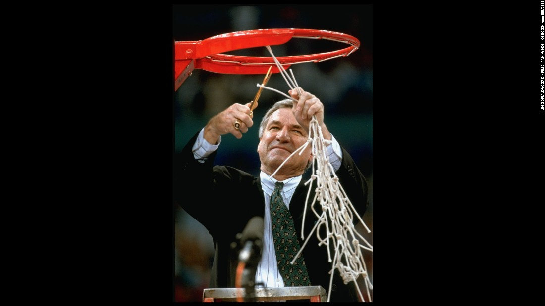 Smith cuts the hoop net after his team captured the 1993 NCAA title. It was his second title as coach of the Tar Heels.