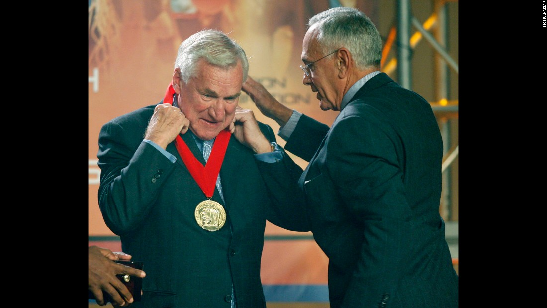 Larry Brown presents Smith with a medal during Smith's induction into the National Collegiate Basketball Hall of Fame in Kansas City, Missouri, on November 19, 2006. Smith was part of the Hall's inaugural, founding class.