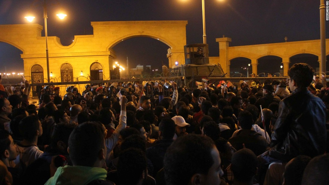Soccer fans confront police outside a stadium in Cairo on Sunday, February 8. At least 19 people were killed in violent clashes ahead of a scheduled match between Zamalek and ENPPI, the Health Ministry said.