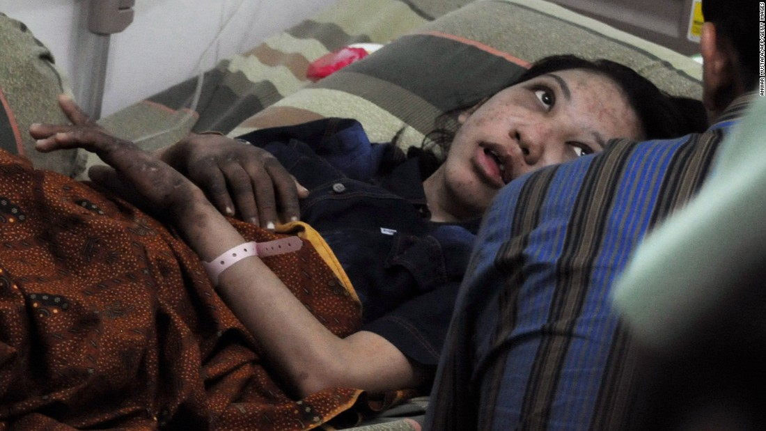 Erwiana is interviewed from her hospital bed in Sragen by authorities on January 21, 2014.