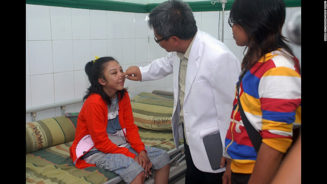 A doctor checks Erwiana before she leaves the hospital in Sragen, Indonesia, on February 5, 2014.