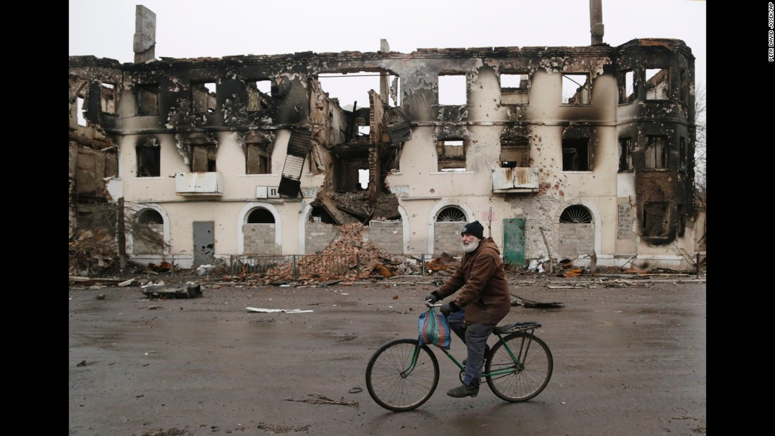 A man rides a bicycle in Vuhlehirsk, Ukraine, on February 6.