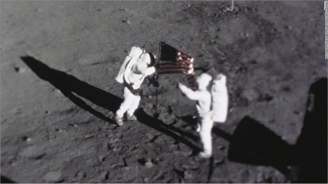 Astronauts Neil Armstrong and Buzz Aldrin place the American flag on the Moon. This image was captured by the Apollo 11 Data Acquisition Camera that was mounted to the lunar module Eagle.