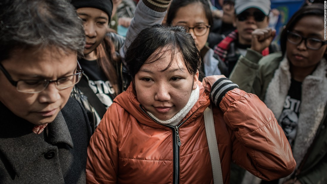 Former domestic worker Erwiana Sulistyaningsih arrives at a Hong Kong court on Tuesday, February 10, ahead of the verdict in an assault case against her former employer.