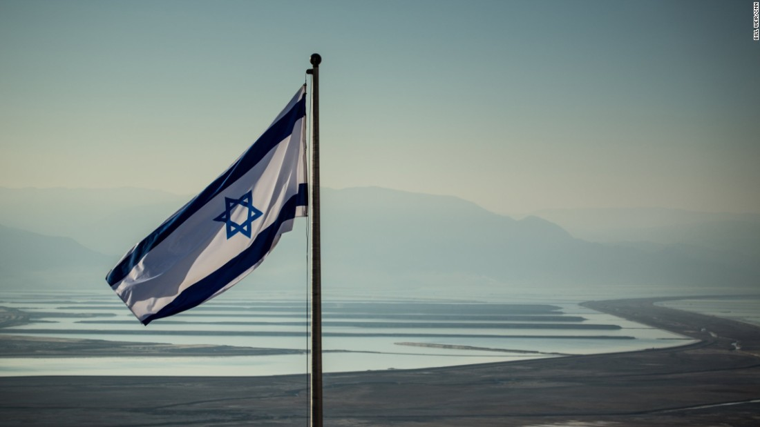 An Israeli flag waves near the evaporation ponds of the Dead Sea, a series of shallow-water reservoirs that capture the runoff from the southern edge of the Dead Sea.