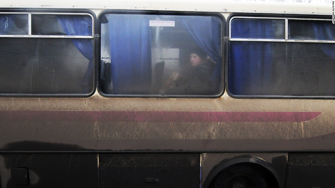 A few residents board a bus to escape the fighting. The road leading to nearby Artyemovsk is a very dangerous route because of shelling by separatists.