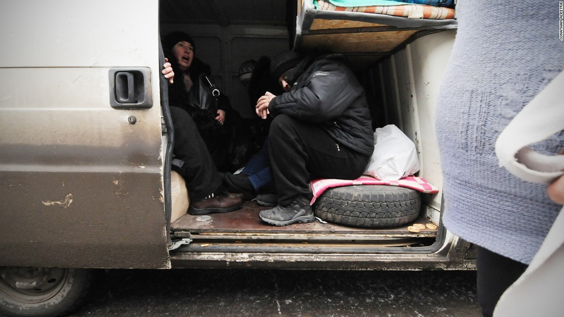 Residents jam a minivan for transport out of the besieged town. Each day, volunteers from all over Ukraine risk their lives to bring food and badly needed supplies.