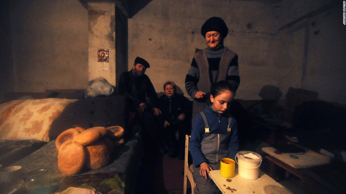 A Debaltseve family has taken refuge in an underground bunker because of the constant shelling. About one third of the houses in the town have been hit by artillery.