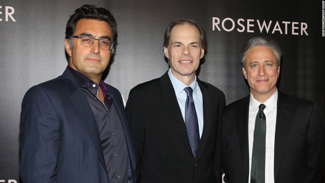 "In 2013, Stewart took a 12-week hiatus from ""The Daily Show"" to make the film ""Rosewater,"" his directorial debut. Released in 2014, the movie tells the story of journalist Maziar Bahari, far left with Tom Ortenberg and Stewart, and his 2009 imprisonment in Iran."