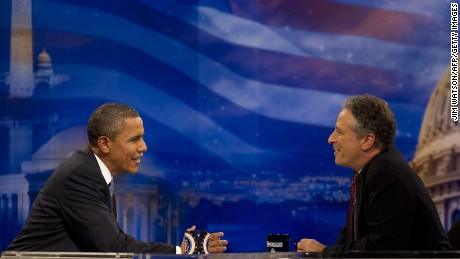 "US President Barack Obama (L) tapes an interview for the satirical television show ""Daily Show"" with Jon Stewart (R) at the Harman Center for the Arts in Washington, DC, October 26, 2010. Obama is the first sitting president to appear on the program hosted by Stewart, whose nightly skewerings of political hypocrisy and US media shortcomings have endeared him to young Democrats.        AFP PHOTO/Jim WATSON (Photo credit should read JIM WATSON/AFP/Getty Images)"