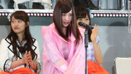 Rina Kawaei, of J-pop group AKB48, makes a public appearance weeks after being attacked with a saw at a fan event.