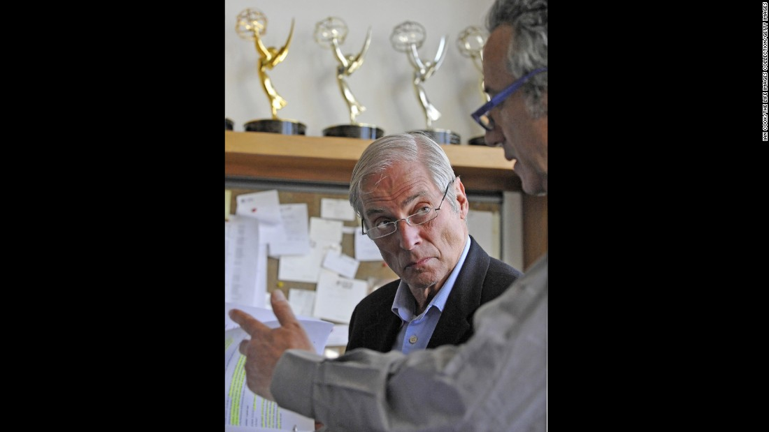 In a March 2010 photo released by CBS, Simon confers with a news producer at the CBS Broadcast Center in New York. Simon's many awards included four Peabodys, 27 Emmys and the Overseas Press Club's highest honor for a body of work.